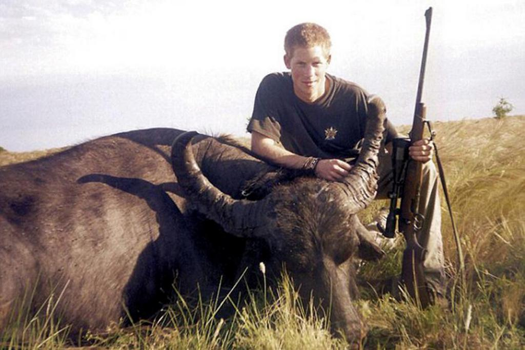 2004_prince_harry_crouches_over_a_water_buffalo_he_shot_and_killed_in_south_america.jpg