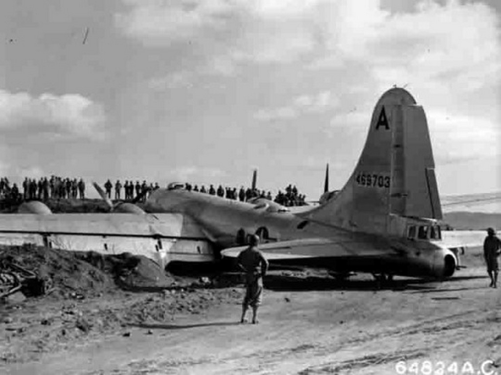 1945_marcius_bomber_b-29-55-bw_after_the_crash_on_the_island_of_iwo_jima.jpg