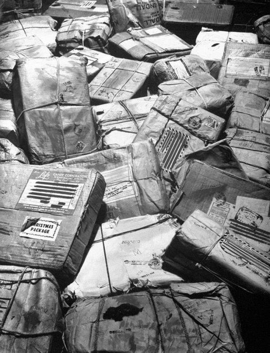1944_christmas_packages_destined_for_soldiers_who_have_been_killed_or_are_missing_in_action_await_return_to_sender_stamps_new_york_city.jpg