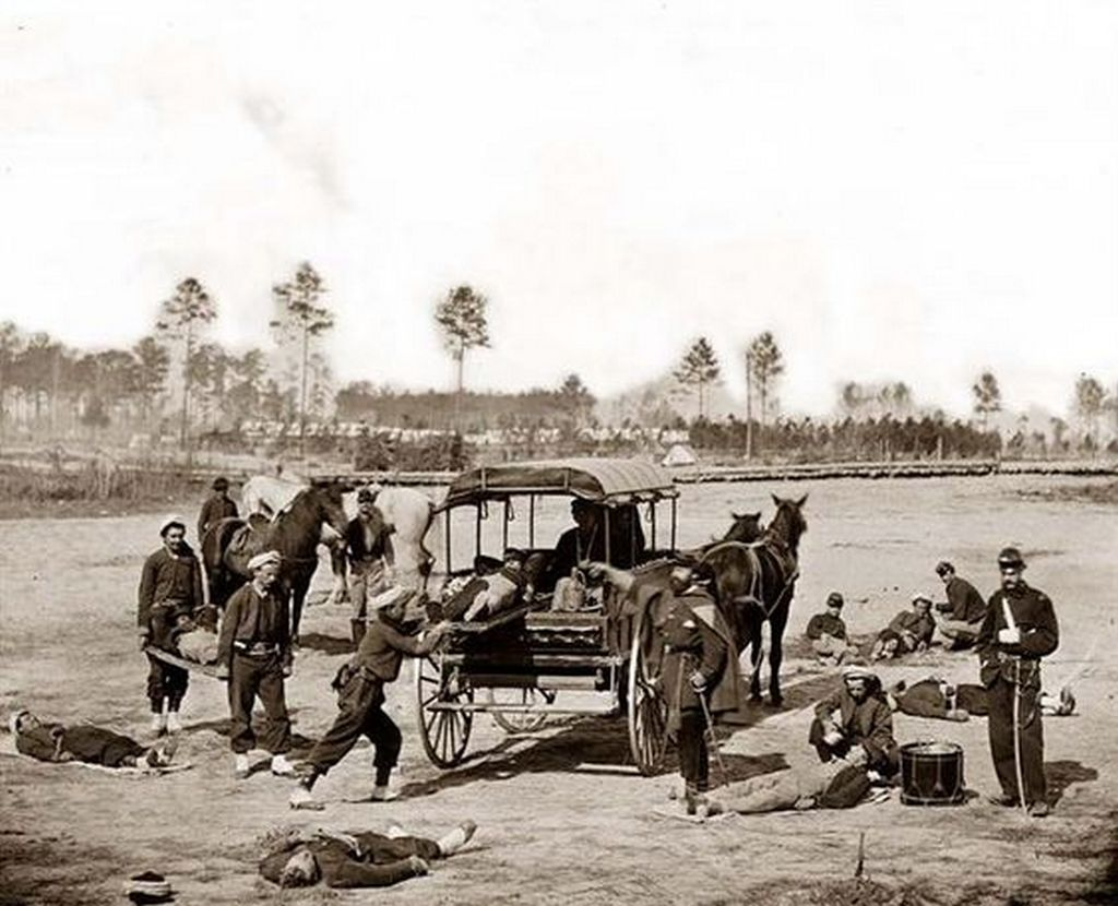 1862_the_image_shows_a_civil_war_ambulance_crew_removing_the_wounded_from_a_battlefiled.jpg