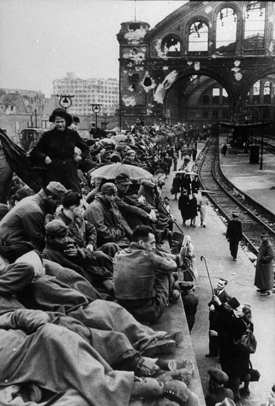 1945_junius_throngs_of_german_citizens_crowd_the_platforms_of_the_berlin_train_station_shortly_following_the_defeat_of_germany.jpg
