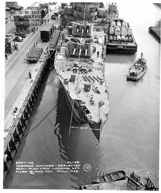 1943_uss_st_louis_1943_the_st_louis_after_the_battle_of_kolombangara_showing_torpedo_damage_at_her_bow.jpg