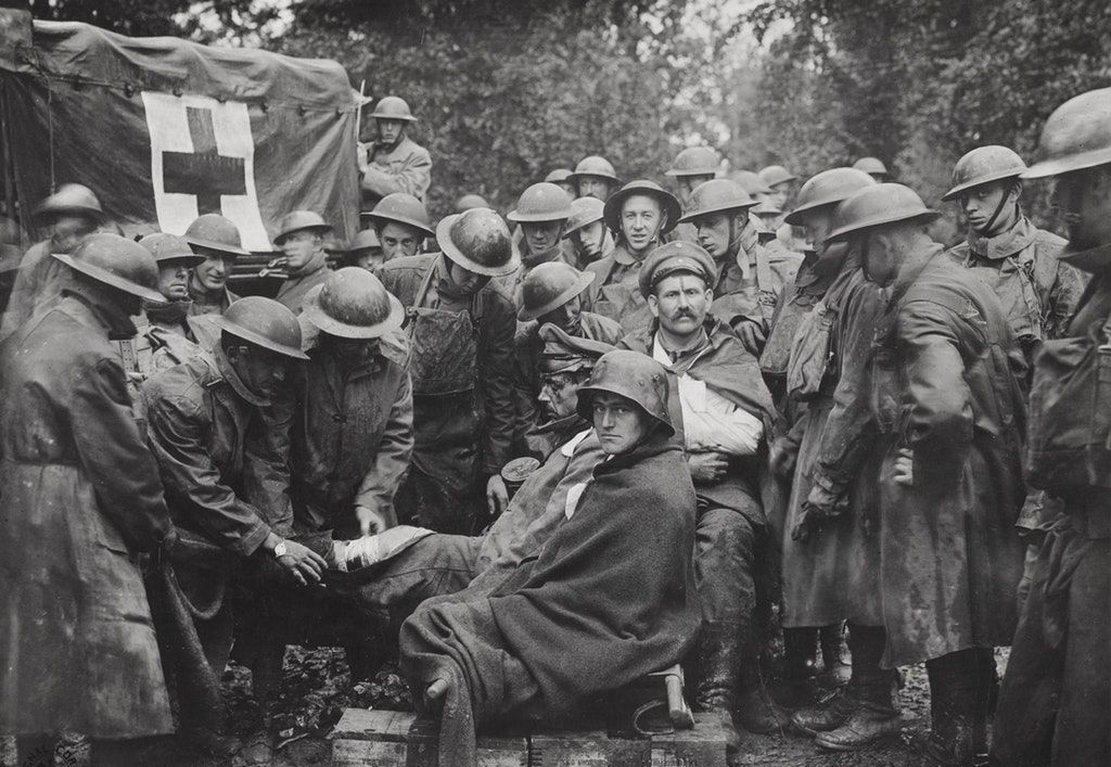 1918_wounded_german_prisoners_receiving_medical_attention_at_first_aid_station_of_103rd_and_106th_ambulance_companies_26th_division_german_second_line_trench_france.jpg
