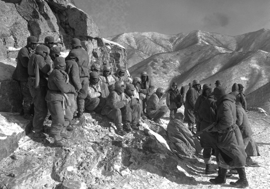 1950_chinese_communist_troops_wearing_tennis_sneakers_rags_and_american_footgear_surrender_to_charley_company_7th_marines_south_of_koto-ri_north_korea.jpg