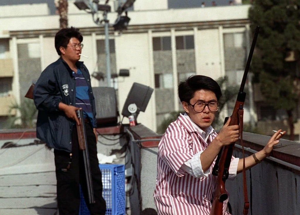 1992_rooftop_koreans_defending_their_businesses_during_the_l_a_race_riots.jpg