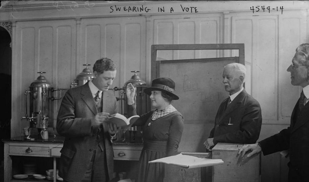 1918_helen_moser_swearing_in_to_vote_march_5_1918_the_first_woman_allowed_to_vote_in_nyc_cr.jpg