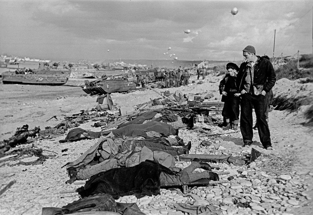 1944_french_fishermen_after_d-day_looking_at_the_bodies_of_american_soldiers_who_were_killed_during_the_landing_to_free_europe_from_the_horror_of_german.jpg