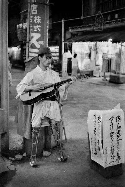 1951_asakusa_district_in_tokyo_a_former_soldier_wounded_during_the_second_world_war_begging_in_the_streets.jpg