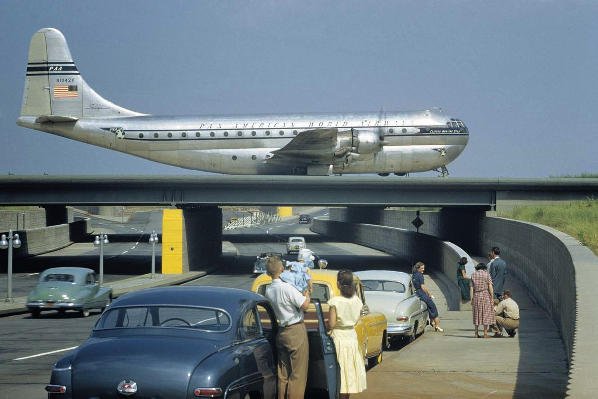 1951_sightseers_park_to_watch_a_stratocruiser_taxi_across_an_underpass_in_queens_new_york.jpg