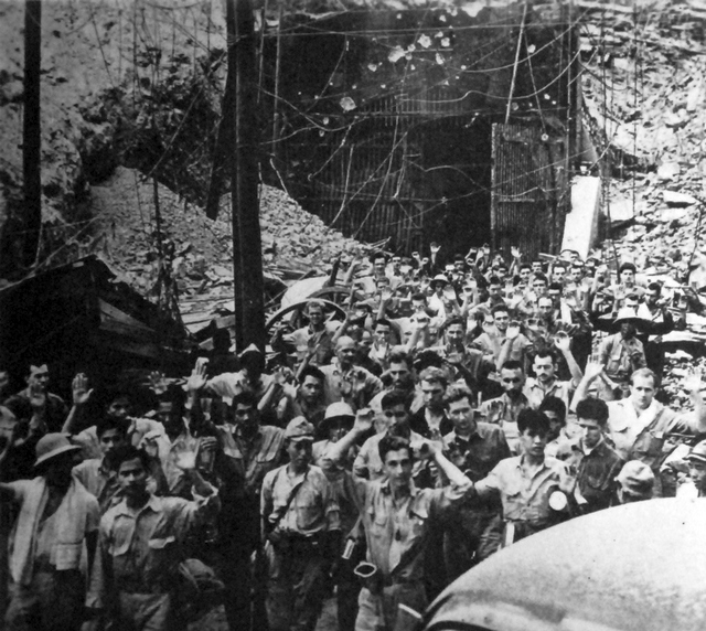 1942_majusa_japanese_photograph_of_us_soldiers_and_sailors_surrendering_to_japanese_forces_at_corregidor_philippines.jpg