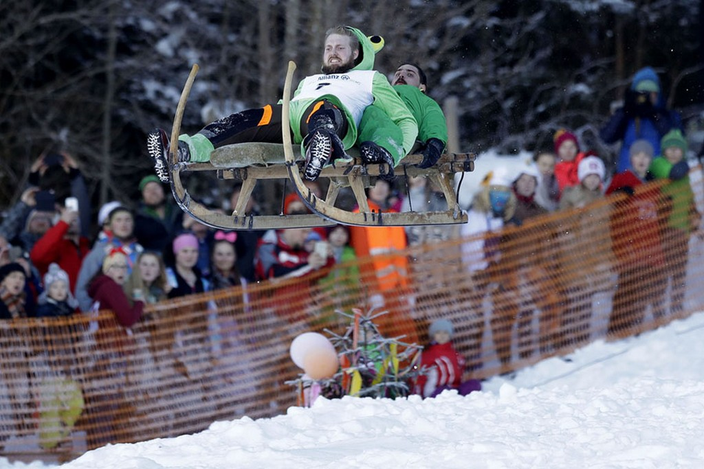 2017_01_22_men_soar_through_the_air_on_their_wooden_sled_during_a_traditional_bavarian_horn_sled_race_known_as_schnablerrennen_in_gaissach_near_bad_toelz_germany.jpg
