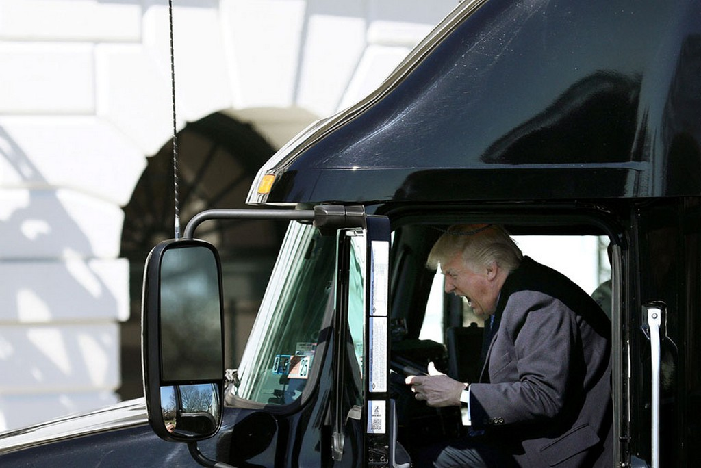 2017_03_23_president_donald_trump_reacts_as_he_sits_in_a_truck_while_he_welcomes_truckers_white_house_w.jpg