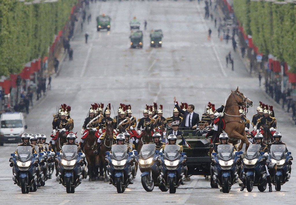 2017_05_14_a_horse_from_the_republican_guard_rears_up_as_newly-elected_french_president_emmanuel_macron_waves_from_a_military_vehicle_while_riding_on_the_champs_elysees.jpg