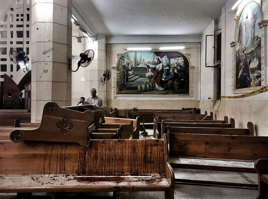2017_06_09_bloodstains_remain_on_pews_inside_st_george_church_after_a_suicide_bombing_in_the_nile_delta_town_of_tanta_egypt_over_40_killed.jpg