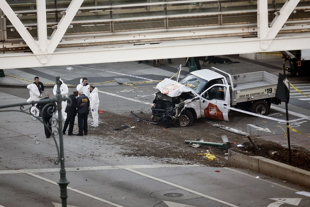 2017_10_31_authorities_stand_near_a_damaged_home_depot_pickup_truck_after_its_driver_drove_onto_a_bike_path_near_the_world_trade_center_memorial_in_new_york_striking_and_killing_eight_people_on_october_31.jpg
