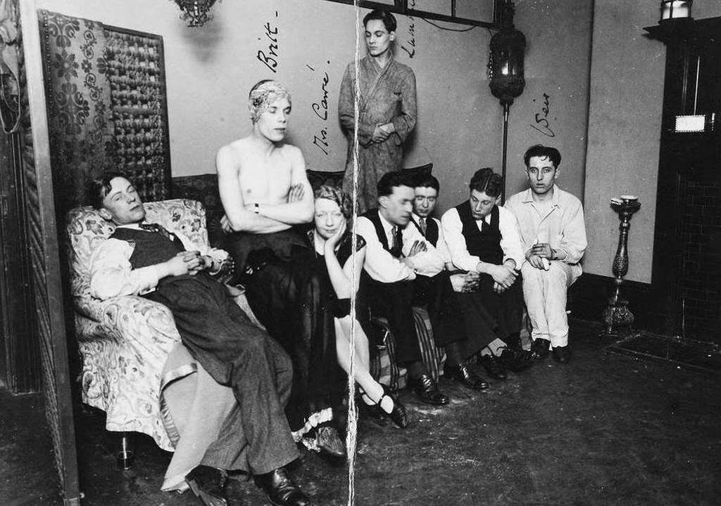 1927_a_photograph_of_eight_people_taken_by_police_during_a_raid_on_a_gay_club_in_fitzroy_square.jpg