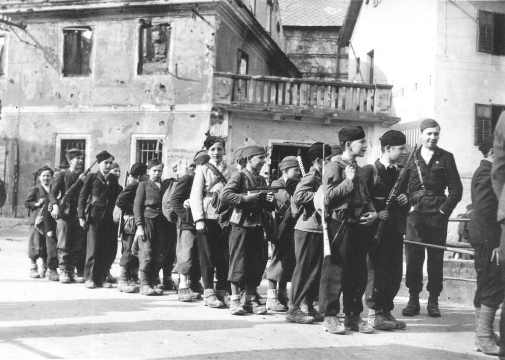 1945_serbian_boys_of_the_partisan_communist_union_of_pioneers_of_yugoslavia_young_pioneer_detachment_rakitovec_from_zeleznik_serbia_arrive_at_a_youth_conference_in_cerkno_slovenia.jpg
