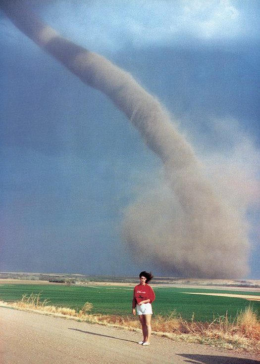 1989_just_a_woman_posing_with_a_tornado_in_oklahoma.jpg