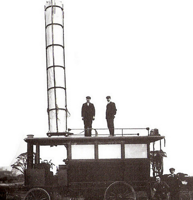 1901_guglielmo_marconi_standing_far_right_beside_the_first_motor_vehicle_to_have_a_radio_the_tube_on_the_roof_is_the_aerial.png