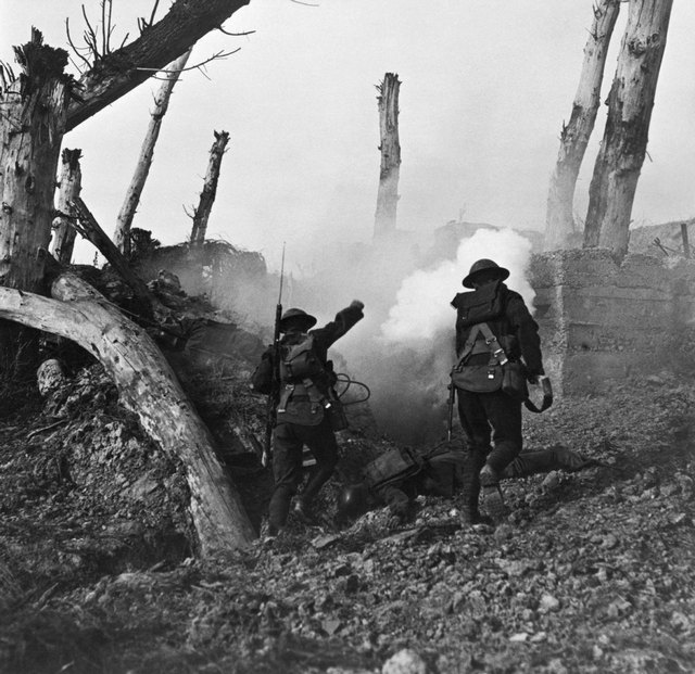 1917_two_united_states_soldiers_run_past_the_remains_of_two_german_soldiers_toward_a_bunker.jpg