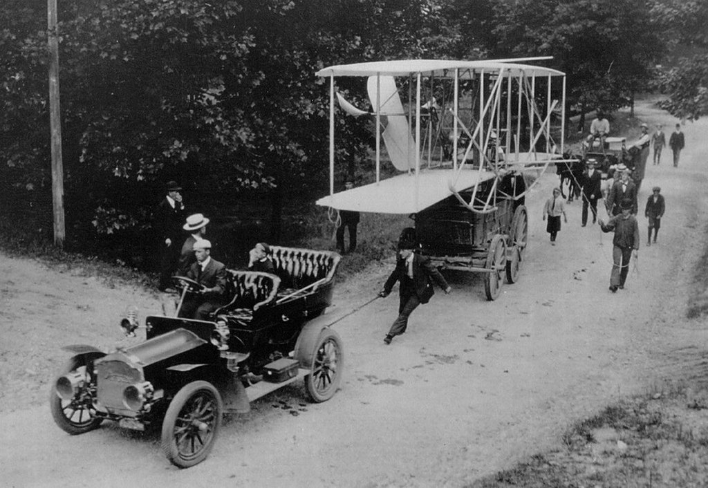 1908_the_wright_airplane_being_towed_to_the_parade_grounds_of_fort_meyer_virginia.jpg