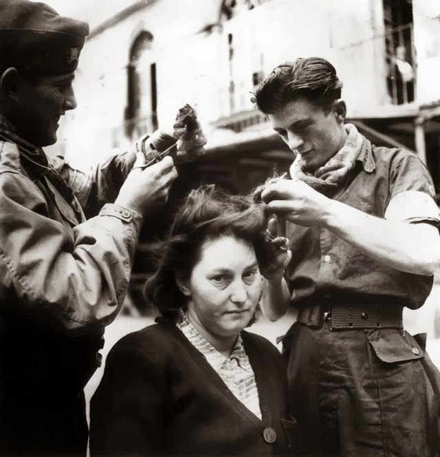 1944_french_woman_having_her_hair_cut_before_her_head_was_shaved_for_collaboration_with_germans_during_the_occupation_france.jpg