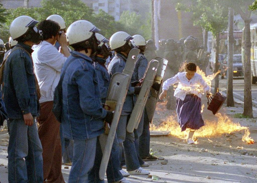 1988_a_korean_woman_is_engulfed_flames_from_a_firebomb_thrown_during_an_anti-government_demonstration_at_dankook_university_in_seoul.jpg