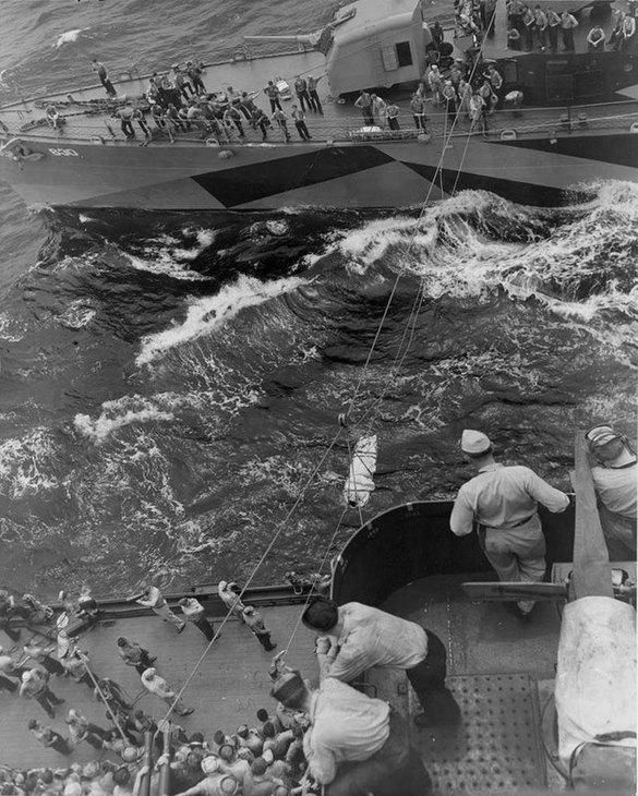1944_junius_14_the_uss_braine_dd-630_transfers_wounded_to_the_battleship_uss_new_mexico_bb-40_after_being_hit_by_a_japanese_six-inch_shore_battery_off_the_mariana_islands_on.jpg