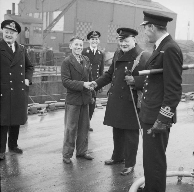 1941_winston_churchill_shakes_hands_with_16_year_old_george_smith_at_portsmouth_dockyard_on_31_january_1941_smith_claimed_to_be_the_youngest_worker.jpg