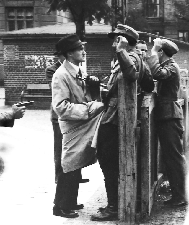 1945_danish_resistance_fighters_hold_up_and_disarm_two_german_soldiers_copenhagen.png