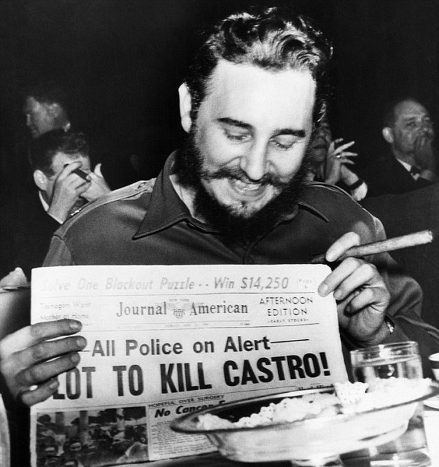 1959_fidel_castro_laughing_at_a_newspaper_headline_while_visiting_new_york.jpg