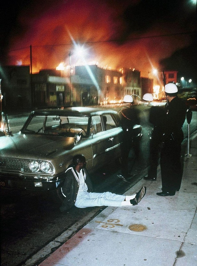 1965_augusztus_11_police_detaining_a_man_during_the_watts_riots_in_los_angeles_california.jpg