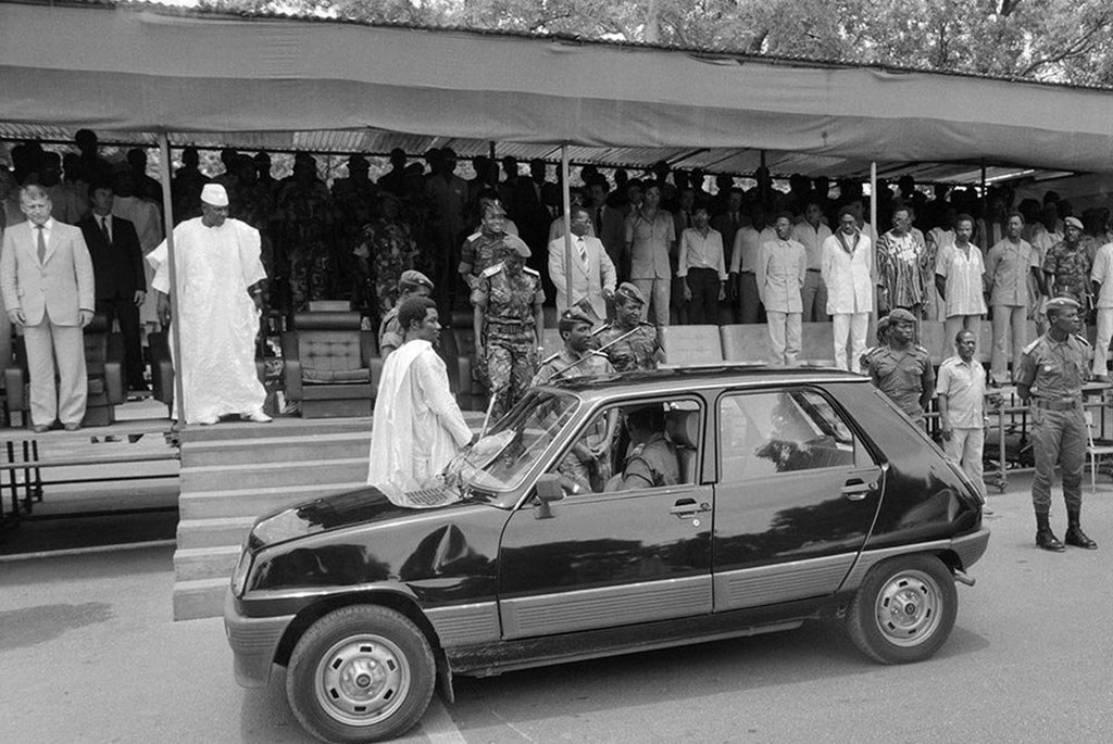 1985_burkina_faso_president_thomas_sankara_in_front_of_his_renault_5_during_an_official_ceremony_for_the_second_anniversary_of_burkina_faso_s_revolution_replace_the_official_fleet_of_mercedes_cheaper_r5_ouagadougou.jpg