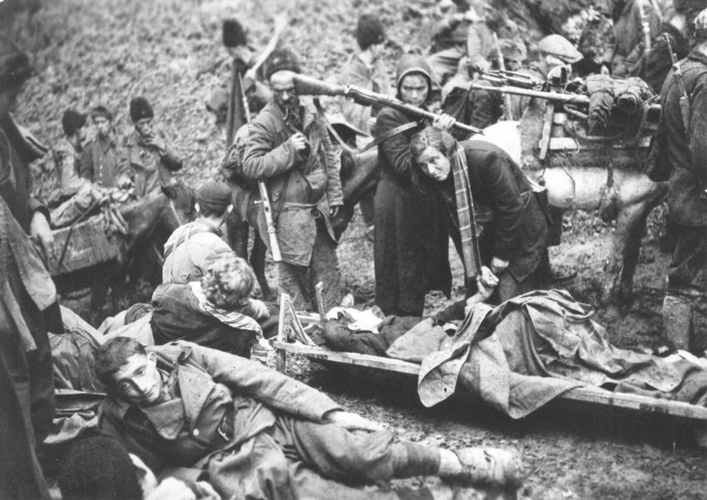 1943_junius_9_yugoslavian_partisans_retreating_through_the_mountains_during_the_battle_of_sutjeska.jpg