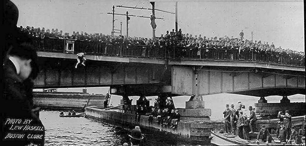 1908_harry_houdini_jumping_off_the_harvard_bridge_into_the_charles_river_while_chained_and_manacled_cambridge_massachusetts.jpg