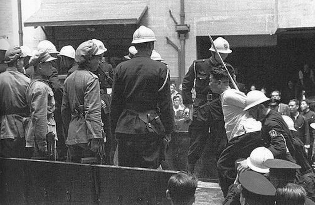 1949_an_alleged_communist_is_loaded_into_a_truck_for_execution_outside_the_city_by_kuomintang_authorities_shanghai.jpg