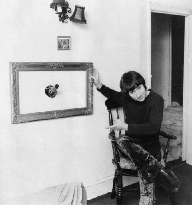 1968_keith_moon_the_drummer_for_the_who_posing_with_the_frame_he_put_around_a_champagne_bottle_stuck_in_the_wall_after_he_had_thrown_it_at_his_wife_and_missed.jpg