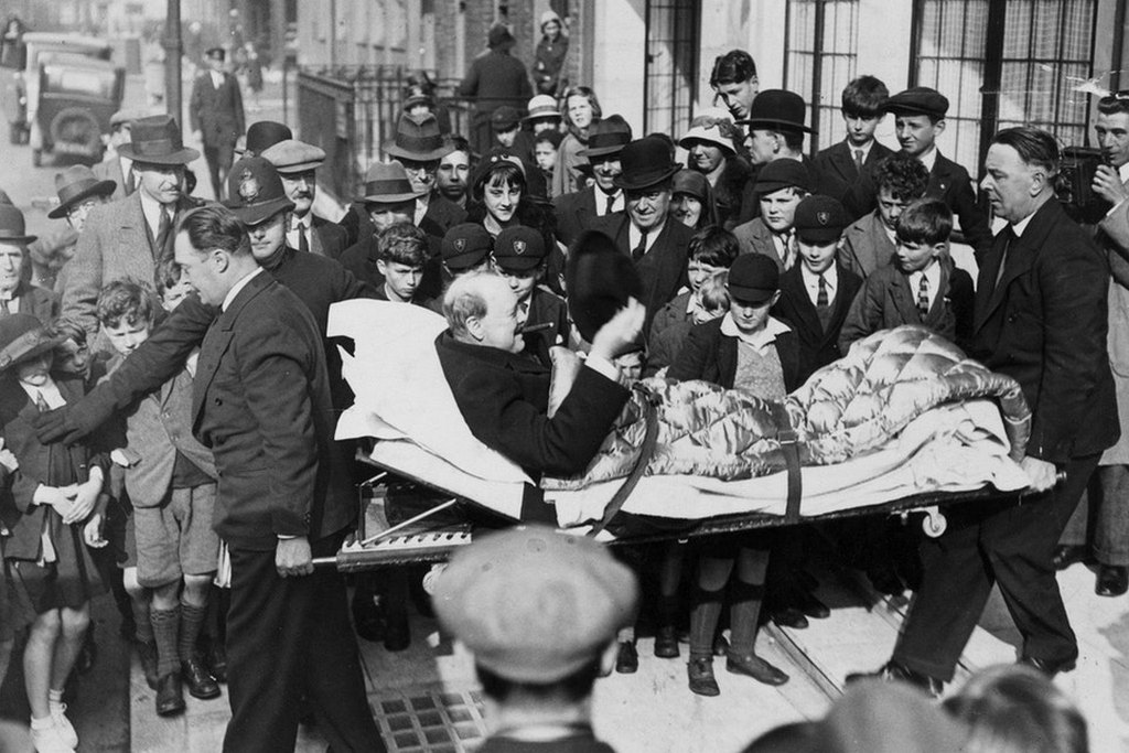 1932_winston_churchill_being_carried_into_a_nursing_home_on_a_stretcher_after_being_hit_by_a_car_in_new_york_city.jpg