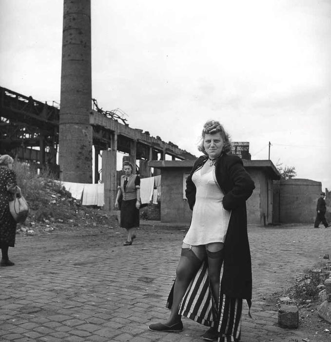 1947_a_sex_worker_outside_the_krupp_works_in_essen_germany.jpg