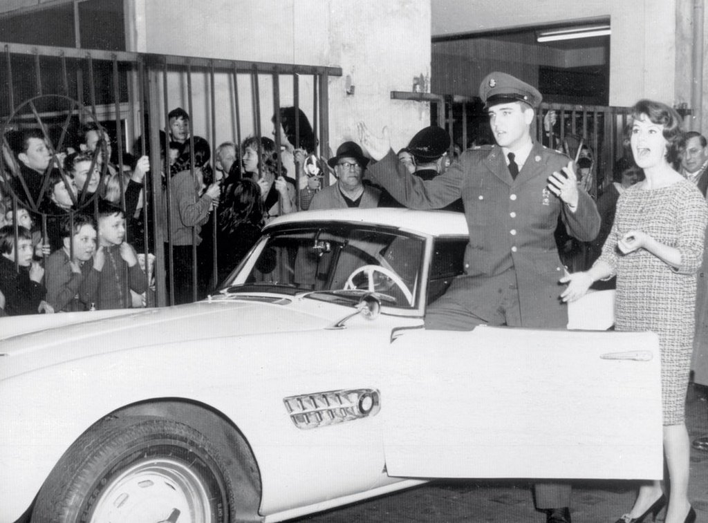 1958_elvis_with_his_bmw_507_and_local_tv_personality_uschi_siebert_in_germany.jpg