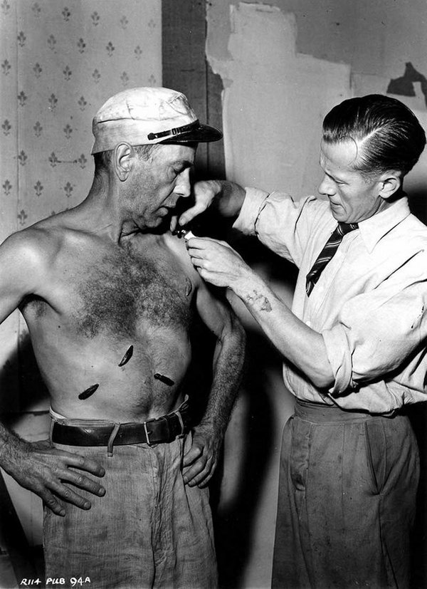 1951_humphrey_bogart_having_rubber_leeches_applied_to_his_chest_for_the_filming_of_the_african_queen.jpg