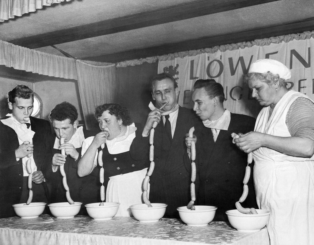 1952_a_sausage_eating_contest_in_munich_germany.jpg