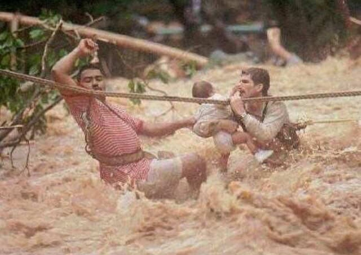 1996_two_men_and_a_child_trying_to_survive_hurricane_hortense_puerto_rico.jpg