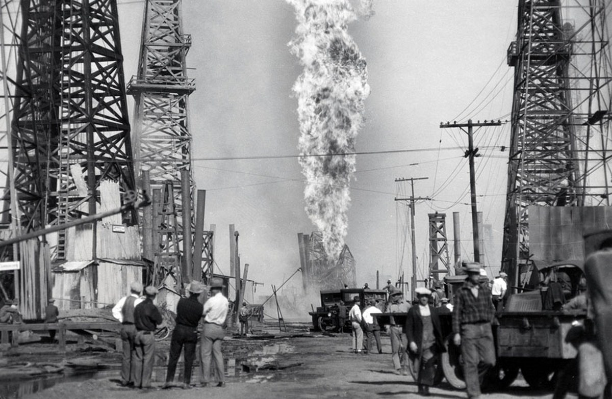 1928_a_furious_pillar_of_fire_from_an_oil_well_causes_tremendous_losses_at_santa_fe_springs_california.jpg