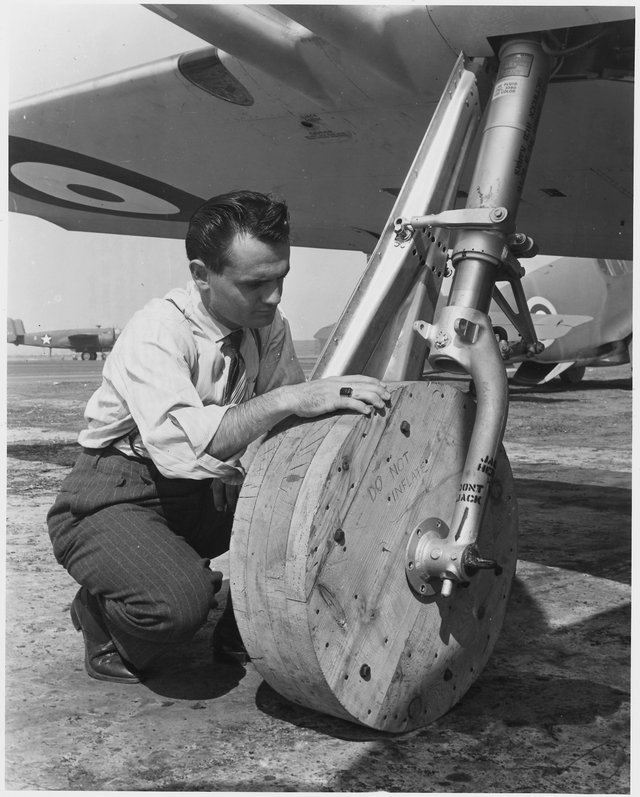 1942_oktober_with_rubber_tires_in_short_supply_wooden_wheels_are_attached_to_a_p-51_mustang_fighter_plane_so_it_may_be_moved_around_the_ramp_at_the_inglewood_calif.jpg