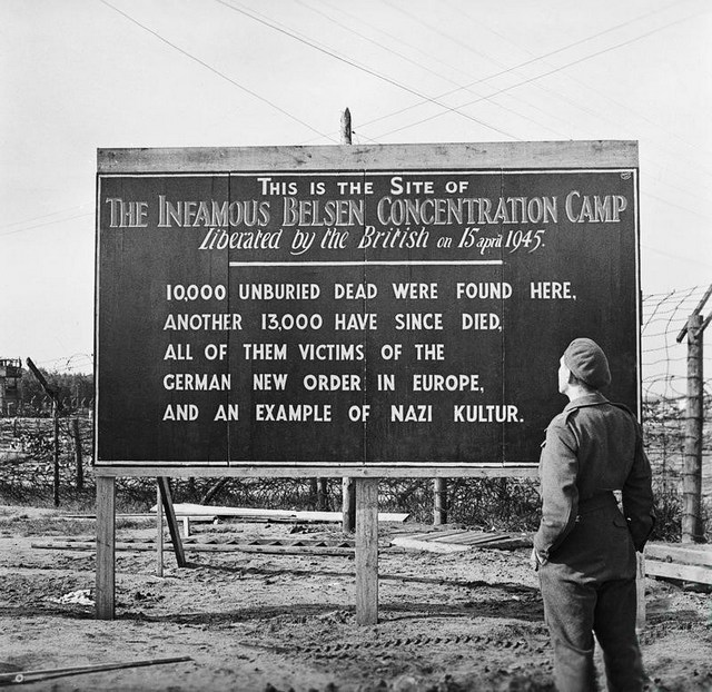 1945_a_sign_erected_by_british_forces_at_the_entrance_to_bergen-belsen_concentration_camp.jpg