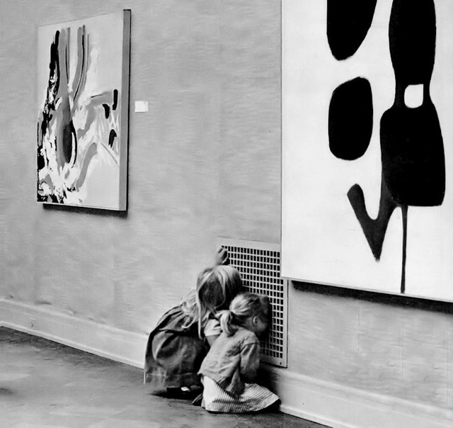 1963_two_girls_more_engrossed_with_the_air_vent_grate_than_the_modern_art_on_the_walls_of_the_san_francisco_museum_of_art.jpg