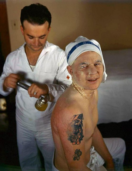 1941_decembere_sailor_being_treated_for_burns_received_during_the_attack_on_pearl_harbor.jpg