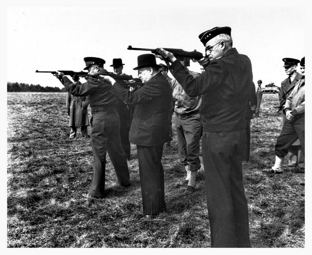1944_eisenhower_churchill_and_bradley_fire_the_new_m1_carbine_in_england.jpg