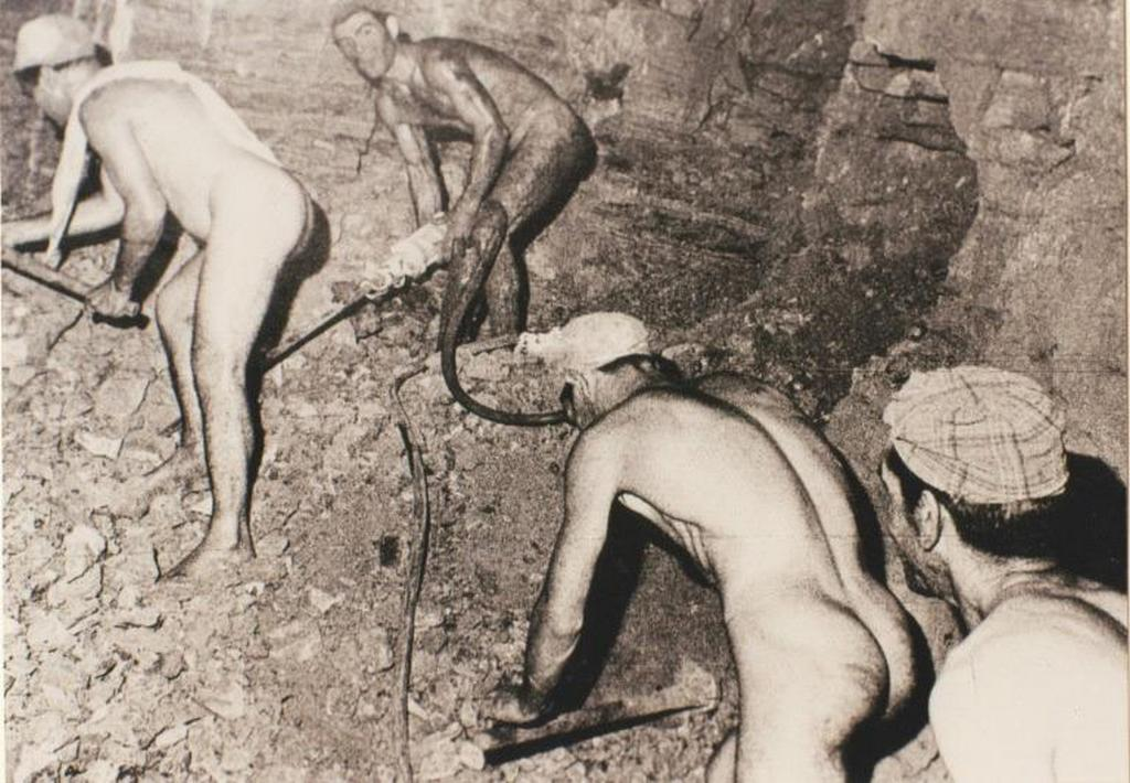 1950_korul_sulfur_miners_working_nude_because_of_the_heat_in_the_floristella_grottacalda_mines_in_sicily.jpg